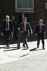 Downing Street, London, July 19th 2016. Scotland Secretary David Mundell, left, Northern Ireland Secretary James Brokenshire and Welsh Secretary Alun Cairns arrive at the first full cabinet meeting since Prime Minister Theresa May took office.