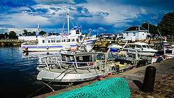 Pleasure craft and fishing boats in the harbour at Honfleur, France