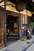 """Takayama Sake Shop - The Cedar Ball means """"sake brew is ready"""" and called a sugidama.  Takayama is well known for its quality sake, in part because of the pure waters in the region."""
