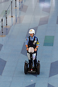 A policeman on a Segway in Haneda International Airport terminal, Tokyo, Japan. Friday August 26th 2016.
