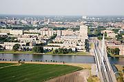 Nederland, Utrecht, Kanaleneiland, 04-07-2006; zicht op de Prins Clausbrug (ontwerp Ben van Berkel) en de flats van het Kanaleneiland, naoorlogse wijk met veeeentonige semi-hoogbouw (portiekflats); Papendorp in de voorgrond wordt een bedrijventerrein / kantorenpark; in de achtergrond binnenstad Utrecht; stadsvernieuwing, stadsontwikkeling, planologie, tuibrug, wonen, woningbouw; luchtfoto (toeslag); aerial photo (additional fee required); .foto Siebe Swart / photo Siebe Swart