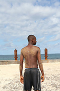 A boy with a sand covered back after laying on the beach on the Marginal 12 Julho, Sao Tome, Sao Tome and Principe<br /> Sao Tome and Principe, are two islands of volcanic origin lying off the coast of Africa. Settled by Portuguese convicts in the late 1400s and later a centre for slaving, their independence movement culminated in a peaceful transition to self government from Portugal in 1975.