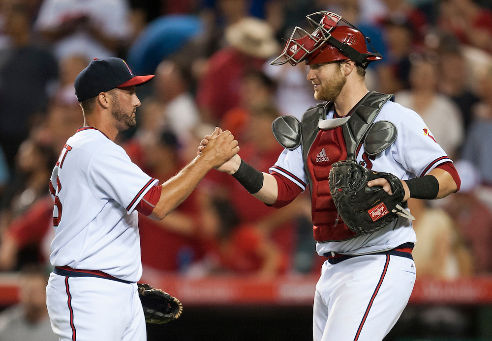 Closer Huston Street and catcher Jett Bandy celebrate after the Angels' 7-4 victory over the Texas Rangers at Angel Stadium on Wednesday.<br /> <br /> ///ADDITIONAL INFO:   <br /> <br /> angels.0721.kjs  ---  Photo by KEVIN SULLIVAN / Orange County Register  -- 7/20/16<br /> <br /> The Los Angeles Angels take on the Texas Rangers at Angel Stadium.