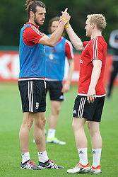 CARDIFF, WALES - Saturday, June 4, 2016: Wales' Gareth Bale and Jonathan Williams during a training session at the Vale Resort Hotel ahead of the International Friendly match against Sweden. (Pic by David Rawcliffe/Propaganda)