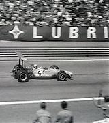 New Zealander Bruce MaClaren drives past pit lane during the 1969 Spanish Grand Prix at the Montjuïc urban circuit in Barcelona, Spain.
