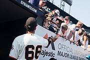 San Francisco Giants left fielder Gorkys Hernandez (66) signs autographs after a game at AT&T Park in San Francisco, California, on August 20, 2017. (Stan Olszewski/Special to S.F. Examiner)