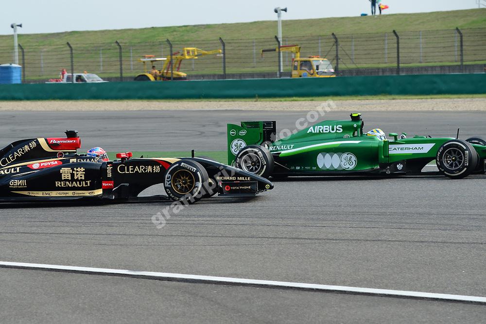 Romain Grosjean (Lotus-Renault) and Marcus Ericsson (Caterham-Renault) during practice for the 2014 Chinese Grand Prix in Shanghai. Photo: Grand Prix Photo