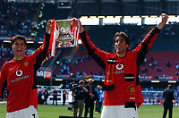 Ruud Van Nistelrooy and team mate Cristiano Ronaldo Manchester United celebrate with the FA Cup<br />Manchester United v Millwall F/A Cup Final 22/05/04<br />Photo Robin Parker Fotosports International