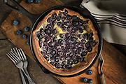 Blueberry Clafoutis by Rodney Bedsole, a food photographer based in Nashville and New York City.