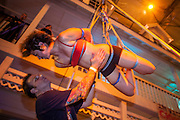 26 MAY 2007 -- A woman hangs suspended during a rope suspension performance at the Fetish Prom at the Venue Nightclub in Scottsdale Saturday night. About 1,200 people, many members of the pangender, pansexual and panfetish community attended the event.  PHOTO BY JACK KURTZ