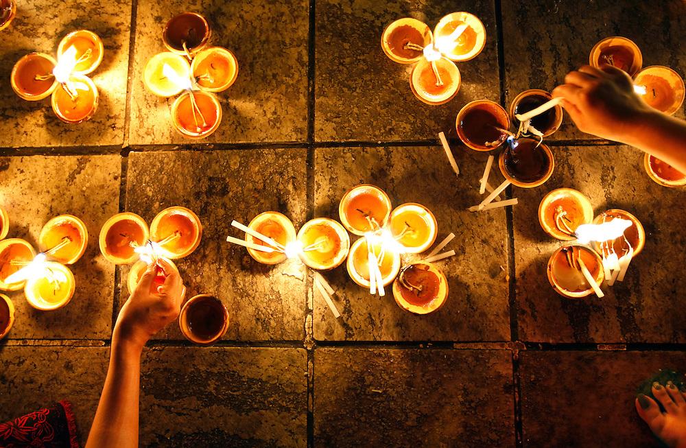 Buddhist devotional candle offerrings. Kyaiktiyo pagoda, the Golden Rock, Myanmar.