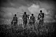 Young Maasai Warriors, calm and courageous beyond their years. They mostly live in balance and harmony with wildlife in the Maasai Mara, Kenya.