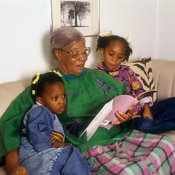 Grandmother reading to her grandchildren