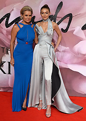 Yolanda Hadid and Gigi Hadid  attending The Fashion Awards 2016 at The Royal Albert Hall in London. <br /> <br /> Picture Credit Should Read: Doug Peters/ EMPICS Entertainment