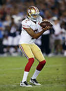 San Francisco 49ers quarterback Colin Kaepernick (7) catches a shotgun snap as he drops back to pass during the 2016 NFL preseason football game against the San Diego Chargers on Thursday, Sept. 1, 2016 in San Diego. The 49ers won the game 31-21. (©Paul Anthony Spinelli)