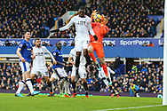Christian Benteke of Crystal Palace jumps for the ball with Everton Goalkeeper Jordan Pickford. Premier league match, Everton v Crystal Palace at Goodison Park in Liverpool, Merseyside on Saturday 10th February 2018. pic by Chris Stading, Andrew Orchard sports photography.