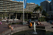 The Barbican Centre is a performing arts centre in the City of London, United Kingdom. Amongst the Brutalist architecture the centre hosts classical and contemporary music concerts, theatre performances, film screenings and art exhibitions. It also houses a library, three restaurants, and a conservatory. The Barbican Centre is member of the Global Cultural Districts Network.
