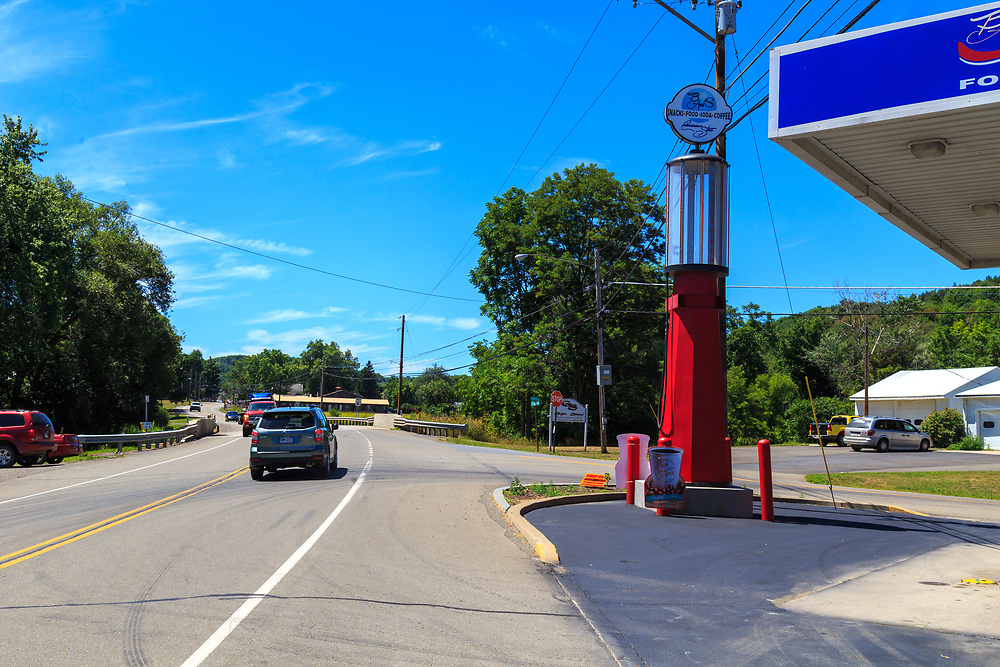 Troy, PA - July 26, 2016: Outside B&S convenience store, a modernized gas station on Route 6 west of Troy, stands a large old-fashioned glass bowl gas pump.