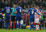 Jamie Vardy of Leicester City protests his innocence at Robert Huth of Leicester City confronts referee Craig Pawson during the English Premier League match at the Bet 365 Stadium, Stoke on Trent. Picture date: December 17th, 2016. Pic Simon Bellis/Sportimage