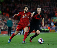 Mohamed Salah of Liverpool tussles with Koke of Atletico Madrid  during the UEFA Champions League match at Anfield, Liverpool. Picture date: 11th March 2020. Picture credit should read: Darren Staples/Sportimage