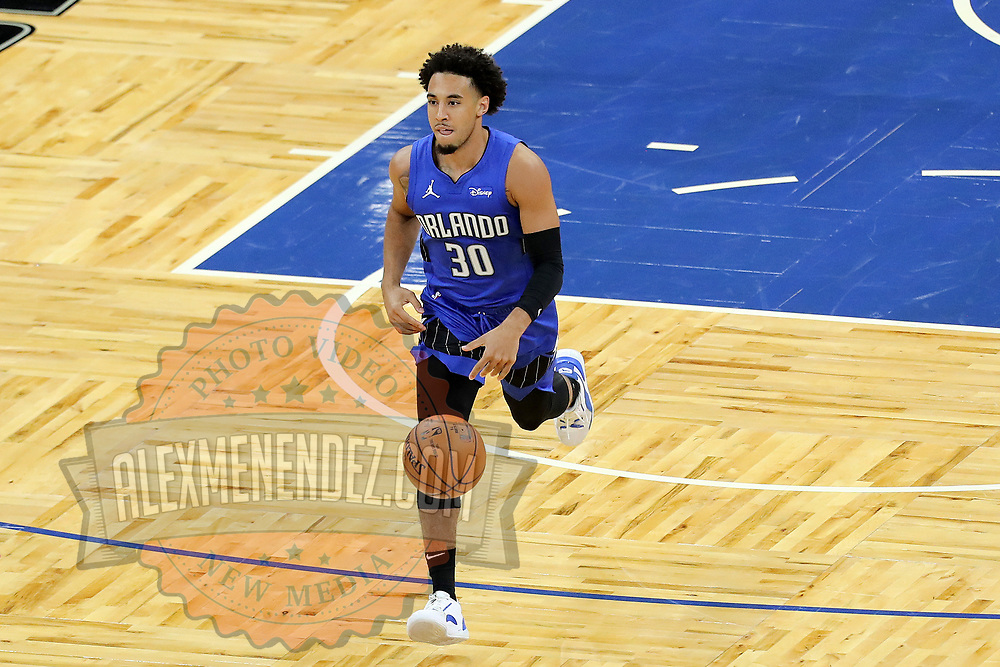 ORLANDO, FL - APRIL 18: Devin Cannady #30 of the Orlando Magic dribbles the ball against the Houston Rockets at Amway Center on April 18, 2021 in Orlando, Florida. NOTE TO USER: User expressly acknowledges and agrees that, by downloading and or using this photograph, User is consenting to the terms and conditions of the Getty Images License Agreement. (Photo by Alex Menendez/Getty Images)*** Local Caption *** Devin Cannady