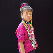 Elizabeth 12, an ethnic Kayaw girl from Myanmar at Baan Tong Luang, Eco-Agricultural Hill Tribes Village on 7th June 2016 in Chiang Mai province, Thailand. The fabricated village is home to 8 different hill tribes who make a living from selling their handicrafts and having their photos taken by tourists  girl at Baan Tong Luang, Eco-Agricultural Hill Tribes Village on 7th June 2016 in Chiang Mai province, Thailand. The fabricated village is home to 8 different hill tribes who make a living from selling their handicrafts and having their photos taken by tourists  girl at Baan Tong Luang, Eco-Agricultural Hill Tribes Village on 7th June 2016 in Chiang Mai province, Thailand. The fabricated village is home to 8 different hill tribes who make a living from selling their handicrafts and having their photos taken by tourists