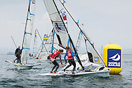 The British Olympic squad pair of Charlotte Dobson and Sophie Ainsworth (in red bibs) round the windward mark while competing in the women's 49erFX class on day four of the ISAF Sailing World Cup at the Weymouth and Portland National Sailing Academy, Weymouth. PRESS ASSOCIATION Photo. Picture date: Saturday June 11, 2016. See PA story SAILING World Cup. Photo credit should read: Chris Ison/PA Wire.