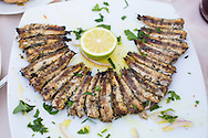 Gero Tsengas, a beautiful restaurant right on the water that serves fresh seafood. Kissamos, Crete, Greece, Europe. Pictured here is a plate of fried sardines