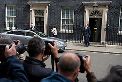 © Licensed to London News Pictures. 08/07/2015. London, UK. British Prime Minister DAVID CAMERON, leaving 10 Downing Street to go to Prime Minister Questions on the day that  British Chancellor of the Exchequer, GEORGE OSBORNE annonces the first fully Conservative budget in 19 years.  Photo credit: Ben Cawthra/LNP