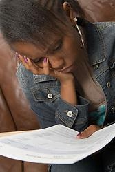 Teenage girl looking at exam results,