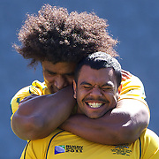 Radike Samo holds Kurtley Beale in a head lock during the Australian team's Captain's run at Eden Park in preparation for the third against fourth play off match with Wales at the IRB Rugby World Cup tournament, Auckland, New Zealand. 20th October 2011. Photo Tim Clayton...