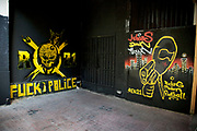 Violent AEK Athens FC graffiti on a wall in the area of Exarhia. Exarcheia, alternatively spelled as Exarchia, Exarheia and Exarhia, is the name of a neighborhood in downtown Athens, Greece close to the historical building of the National Technical University of Athens. The Exarcheia region is famous as a stomping ground for Greek anarchists. It took the name from a merchant named Exarchos who opened a large general store there. Now this graffiti covered area is known as a home for students and members of the anarchist movement and a kind of no go area for tourists. Visitors to Athens can't help but notice the amount of graffiti in the city. Any surface that can be sprayed upon is covered with a maddening number of signatures and designs. Beautifully restored neo-classic houses from the late 19th Century usually have a few days or weeks before they are covered in graffiti and owners find themselves in a war that they eventually lose and surrender to the kids. Graffiti in Athens is as old as the city itself. In ancient times graffiti was carved into buildings, in fact the word comes from the Greek graphi which means to write. The most disturbing aspect of the graffiti besides the volume of it, is the way some of the kids whose artistic ability begins and ends with their names (tags), have defaced some of the real works of art. Athens is the capital and largest city of Greece. It dominates the Attica periphery and is one of the world's oldest cities, as its recorded history spans around 3,400 years. Classical Athens was a powerful city-state. A centre for the arts, learning and philosophy.
