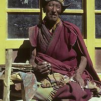 Tibetan Buddhist lama with rosary & prayer books. Rangdum Gompa (monastery) Zanskar (part of Ladakh) India.