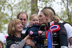 © licensed to London News Pictures. London, UK 08/05/2012. Claire Lomas, who paralysed from the chest down after an accident, finishes the London Marathon and kissing her 15 month-old daughter Maisie Spincer, today after 16 days with a robotic suit to raise money for Spinal Research (08/05/12). Photo credit: Tolga Akmen/LNP