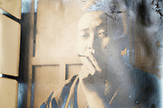 deteriorating casual portrait of a man smoking Japan ca 1950s