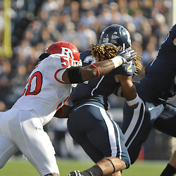 Oct 31, 2009; East Hartford, CT, USA; Rutgers linebacker Antonio Lowery (50) wraps up Connecticut running back Andre Dixon (2) during first half Big East NCAA football action between Rutgers and Connecticut at Rentschler Field.