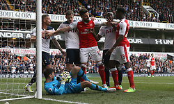 30 April 2017 London : Premier League Football : Tottenham Hotspur v Arsenal :<br /> Olivier Giroud intervenes as Toby Alderweireld of Tottenham and Danny Welbeck of Arsenal clash about a challenge on Tottenham goalkeeper Hugo Lloris.<br /> Photo: Mark Leech