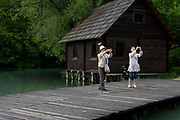 Asian tourists taking photographs in Plitvice National Park, Croatia. Part of a story on Croatia's hidden landscape and undiscovered tourism.