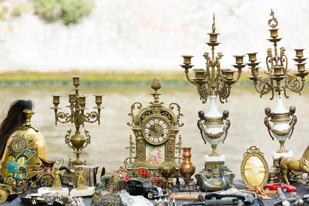Antiques and bric a brac objects - candelabra and ornaments - at street stall at market in Bruges, Belgium