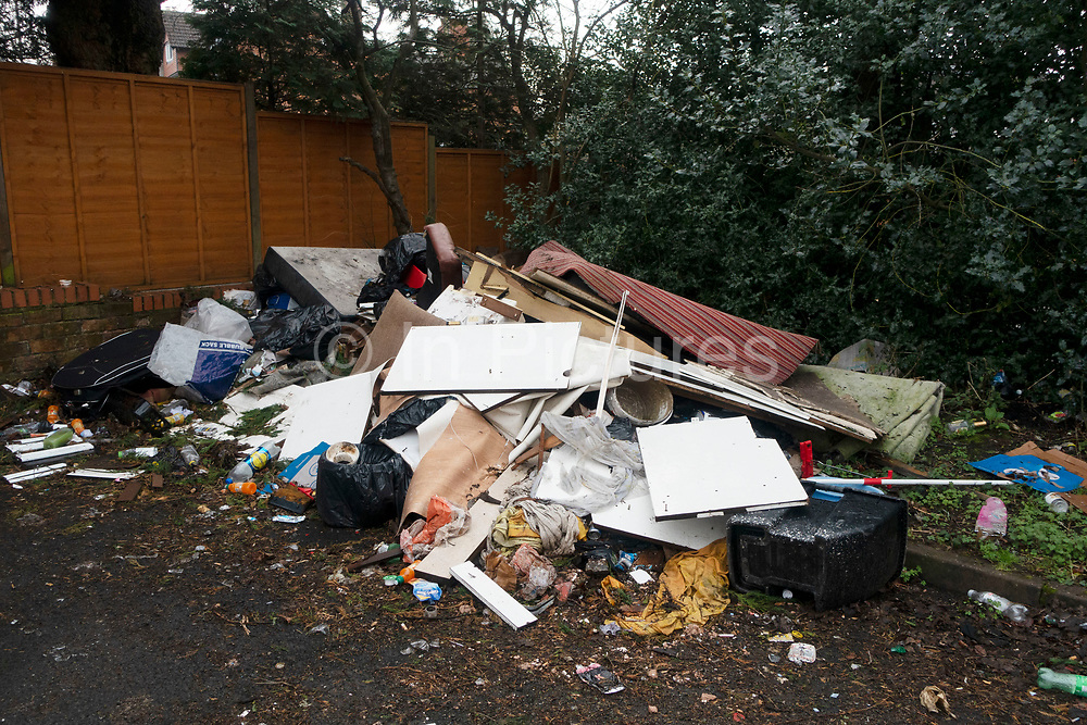 Fly Tipping site in Kings Heath area of Birmingham, United Kingdom. Fly tipping is the illegal dumping of waste instead of using an authorised message such as collection or using a rubbish dump.