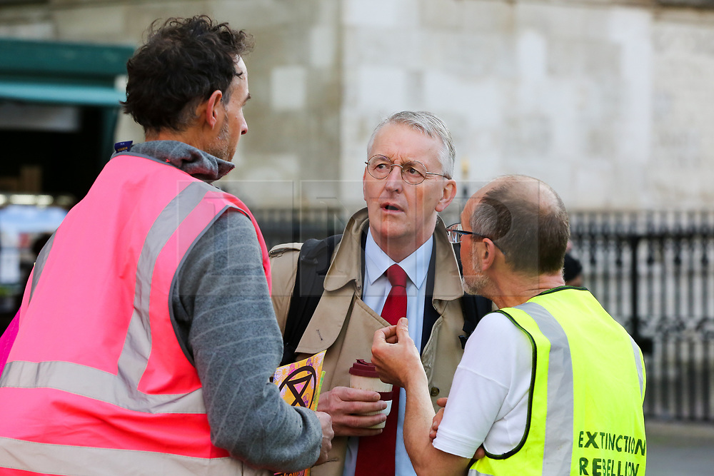 © Licensed to London News Pictures. 09/10/2019. London, UK. Campaigners from Extinction Rebellion movement speak with HILARY BENN MP for Leeds Central in Westminster on day three of the two weeks protest. The activists are calling for the government to act on climate change. Photo credit: Dinendra Haria/LNP