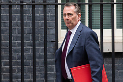 © Licensed to London News Pictures. 10/07/2018. London, UK. Secretary of State for International Trade Liam Fox arrives on Downing Street for the Cabinet meeting. Photo credit: Rob Pinney/LNP