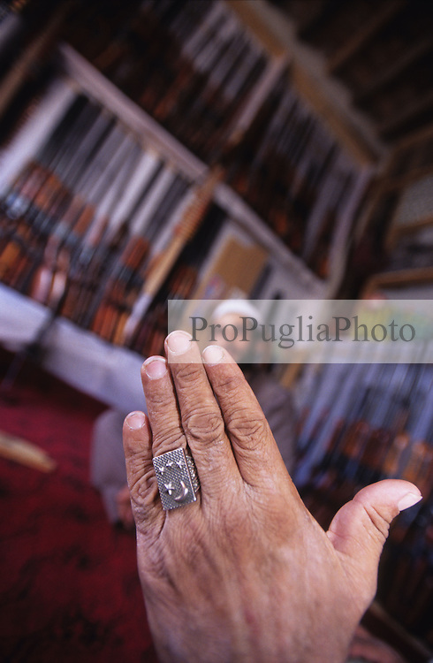 Kabul, 14 August 2005...In a local gun's shop, a Pakistani proudly show his ring...