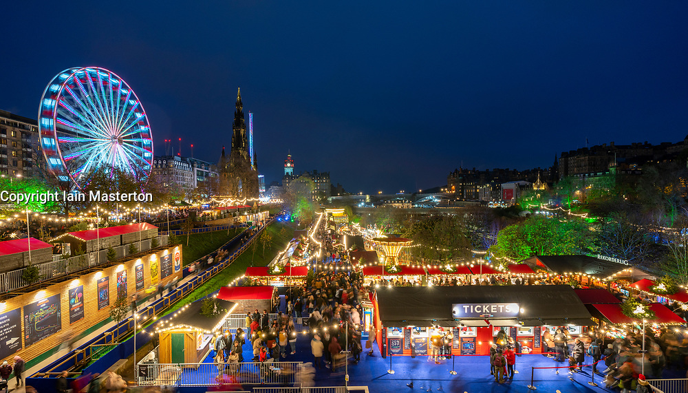 Edinburgh, Scotland, UK. 16th November 2019. View of the opening evening of the annual Edinburgh Christmas Market in East Princes Street Gardens. The market has been controversial with issues regarding planning permission and the much lager size of the market that  required construction of a large elevated platform in the gardens. However this did not deter thousands of visitors who crowded into the market this evening. Iain Masterton/Alamy Live News.