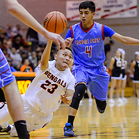 Gallup Bengal Shawn Eskeets (23) passes the ball away as he loses his footing on a break around Sandia Prep Sundevil Antonio Acosta (4) Friday at Gallup High School. .