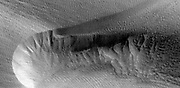 Three images of the same location taken at different times on Mars show seasonal activity causing sand avalanches and ripple changes on a Martian dune. HiRISE.