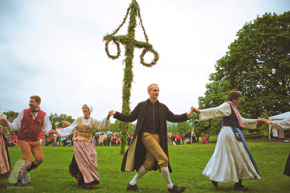 People wearing traditional clothes celebrate midsummer in Karlskoga, Sweden.