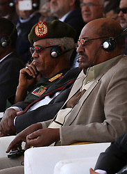 File photo dated January 24, 2016 of Defense Minister Awad Mohamed Ahmed Ibn Auf and President Omar al-Bashir at a ceremony in Sudan. President Omar al-Bashir has been detained and a military council will run the country for a two-year transitional period, Sudan's defense minister announced Thursday, bringing an end to Bashir's 30-year reign. In a statement broadcast on state TV, Defense Minister Awad Mohamed Ahmed Ibn Auf, dressed in military fatigues, said there would be elections at the end of the transition period. Photo by Depo Photos/ABACAPRESS.COM