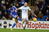 Kadeem Harris  of Cardiff city shoots past Alan Hutton of Aston Villa. EFL Skybet championship match, Cardiff city v Aston Villa at the Cardiff City Stadium in Cardiff, South Wales on Monday 2nd January 2017.<br /> pic by Andrew Orchard, Andrew Orchard sports photography.