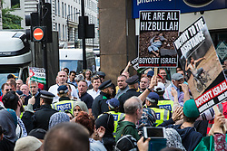 London, UK. 10th June, 2018. Members of a far-right group contest hundreds of people taking part in the pro-Palestinian Al Quds Day march through central London organised by the Islamic Human Rights Commission. An international event, it began in Iran in 1979. Quds is the Arabic name for Jerusalem.